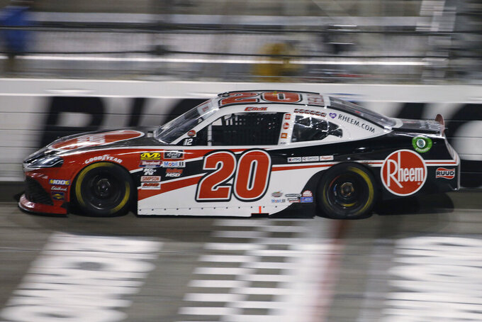 Christopher Bell crosses the start/finish line during the NASCAR Xfinity Series auto race at Richmond Raceway in Richmond, Va., Friday, Sept. 20, 2019. Bell won the race. (AP Photo/Steve Helber)