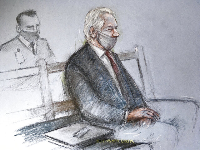 "This is a court artist sketch by Elizabeth Cook of Julian Assange appearing at the Old Bailey in London for the ruling in his extradition case, in London, Monday, Jan. 4, 2021. A British judge has rejected the United States' request to extradite WikiLeaks founder Julian Assange to face espionage charges, saying it would be ""oppressive"" because of his mental health. District Judge Vanessa Baraitser said Assange was likely to kill himself if sent to the U.S. The U.S. government said it would appeal the decision.  (Elizabeth Cook/PA via AP)"