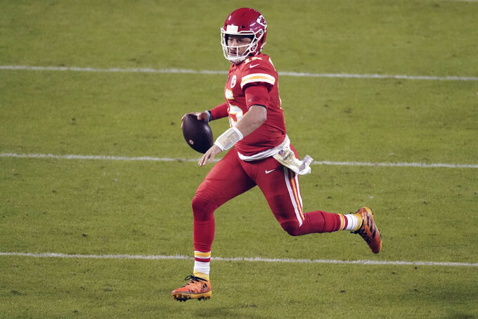 Kansas City Chiefs quarterback Patrick Mahomes (15) runs in the second half of an NFL football game against the Denver Broncos in Kansas City, Mo., Sunday, Dec. 6, 2020. The focus is on the matchup between Patrick Mahomes and Tua Tagovailoa, even though there's no debate about which quarterback is better. The Miami Dolphins might have the superior defense, however, which lends intrigue to Sunday's game against the Kansas City Chiefs.(AP Photo/Charlie Riedel, File)