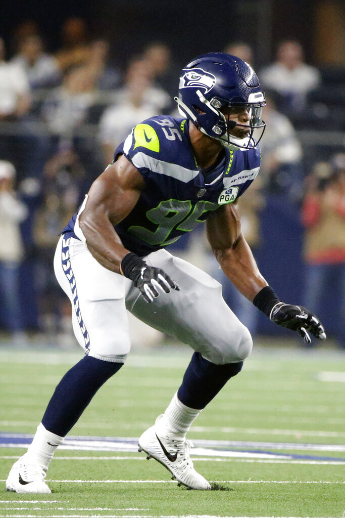 FILE - In this Jan. 5, 2019, file photo, Seattle Seahawks defensive end Dion Jordan (95) plays against the Dallas Cowboys during the second half of the NFC wild-card NFL football game in Arlington, Texas. The San Francisco 49ers have signed defensive lineman Dion Jordan to a one-year contract. The Niners announced the deal Friday, Aug. 7, 2020, to add another former first-round pick to their talented line. (AP Photo/Michael Ainsworth, File)