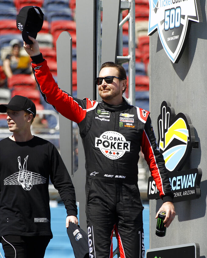 Kurt Busch waves to the crowd during driver introductions prior to the start of the NASCAR Cup Series auto race at ISM Raceway, Sunday, March 10, 2019, in Avondale, Ariz. (AP Photo/Ralph Freso)