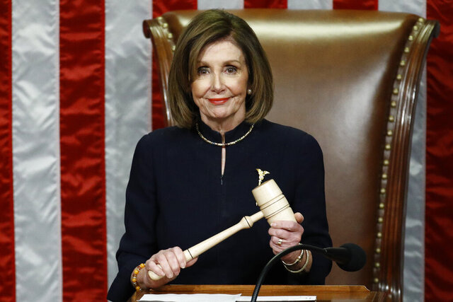 House Speaker Nancy Pelosi of Calif., smiles as she holds the gavel as the House votes on articles of impeachment against President Donald Trump by the House of Representatives at the Capitol in Washington, Wednesday, Dec. 18, 2019.(AP Photo/Patrick Semansky)