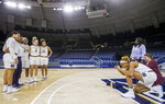 Notre Dame's Brianna Turner, right, takes a photo for teammates during the university's NCAA college basketball media day, Thursday, Oct. 11, 2018, in South Bend, Ind. (Robert Franklin/South Bend Tribune via AP)