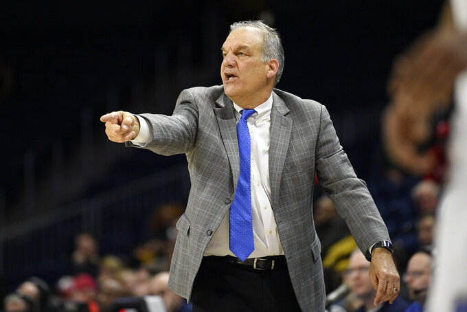 File-This March 10, 2020, file photo shows Hofstra head coach Joe Mihalich reacting during the second half of an NCAA college basketball game in the championship of the Colonial Athletic Association conference tournament against Northeastern in Washington.  Mihalich, who missed last season after taking a medical leave, will shift jobs and become a special adviser to the school's athletic director. The school announced the move Friday, March 19, 2021. In August, Hofstra said the 64-year-old Mihalich would be out but didn't specify the reason.(AP Photo/Nick Wass, File)