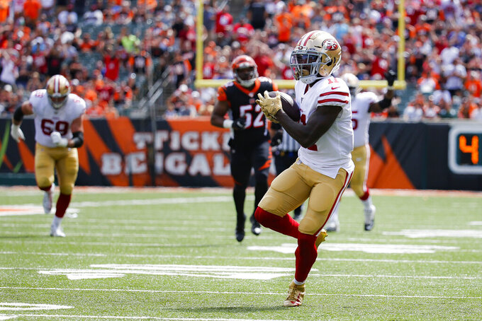 San Francisco 49ers wide receiver Marquise Goodwin (11) runs in a touchdown during the first half an NFL football game against the Cincinnati Bengals, Sunday, Sept. 15, 2019, in Cincinnati. (AP Photo/Frank Victores)
