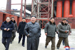 In this undated photo provided on Tuesday, Jan. 7, 2020, by the North Korean government, North Korean leader Kim Jong Un, center, visits a phosphatic fertilizer plant in South Pyongan Province, North Korea. South Korean President Moon Jae-in on Tuesday said he hopes to see Kim fulfill a promise to visit the South this year and called for the Koreas to end a prolonged freeze in bilateral relations. Independent journalists were not given access to cover the event depicted in this image distributed by the North Korean government. The content of this image is as provided and cannot be independently verified. Korean language watermark on image as provided by source reads: