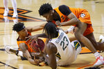 Oklahoma State guard Avery Anderson III, left, forward Matthew-Alexander Moncrieffe, right, and Baylor forward Jonathan Tchamwa Tchatchoua (23) fight for control of the ball in the first half of an NCAA college basketball game Saturday, Jan. 23, 2021, in Stillwater, Okla. (AP Photo/Sue Ogrocki)