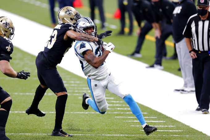 Carolina Panthers defensive back Myles Hartsfield is tackled by New Orleans Saints cornerback Marshon Lattimore (23) in the second half of an NFL football game in New Orleans, Sunday, Oct. 25, 2020. (AP Photo/Brett Duke)