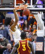 Oklahoma State guard Michael Weathers dunks in front of Iowa State guard Marial Shayok (3) during the second half of an NCAA college basketball game in Stillwater, Okla., Wednesday, Jan. 2, 2019. (AP Photo/Sue Ogrocki)