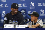 New York Yankees starting pitcher CC Sabathia, left, listens as his son Carter responds to a question during a news conference at the Yankees spring training baseball facility, Saturday, Feb. 16, 2019, in Tampa, Fla. Sabathia announced he will retire after the 2019 season. (AP Photo/Lynne Sladky)