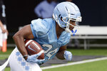 North Carolina running back Antonio Williams (24) runs the ball during NCAA college football practice Friday, Aug. 2, 2019 in Chapel Hill, N.C. (AP Photo/Gerry Broome)