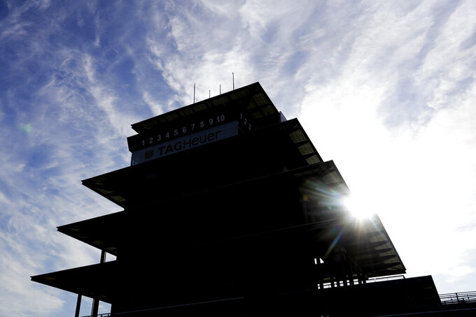The sun rises behind the pagoda at Indianapolis Motor Speedway, Sunday, May 24, 2020, in Indianapolis. (AP Photo/Darron Cummings)