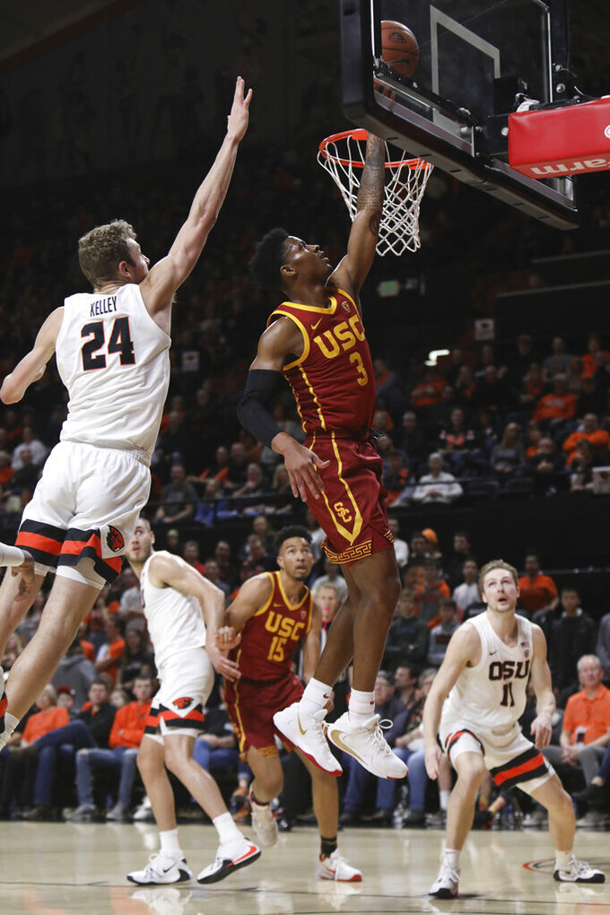 Oregon State's Kylor Kelley (24) tries to block a shot by Southern California's Elijah Weaver (3) during the first half of an NCAA college basketball game in Corvallis, Ore., Saturday, Jan. 25, 2020. (AP Photo/Amanda Loman)