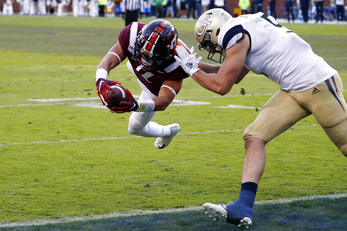 Virginia Tech defensive back Caleb Farley (3) returns an interception for a touchdown as Georgia Tech tight end Tyler Davis (9) defends in the first half of an NCAA football game Saturday, Nov. 16, 2019, in Atlanta. (AP Photo/John Bazemore)