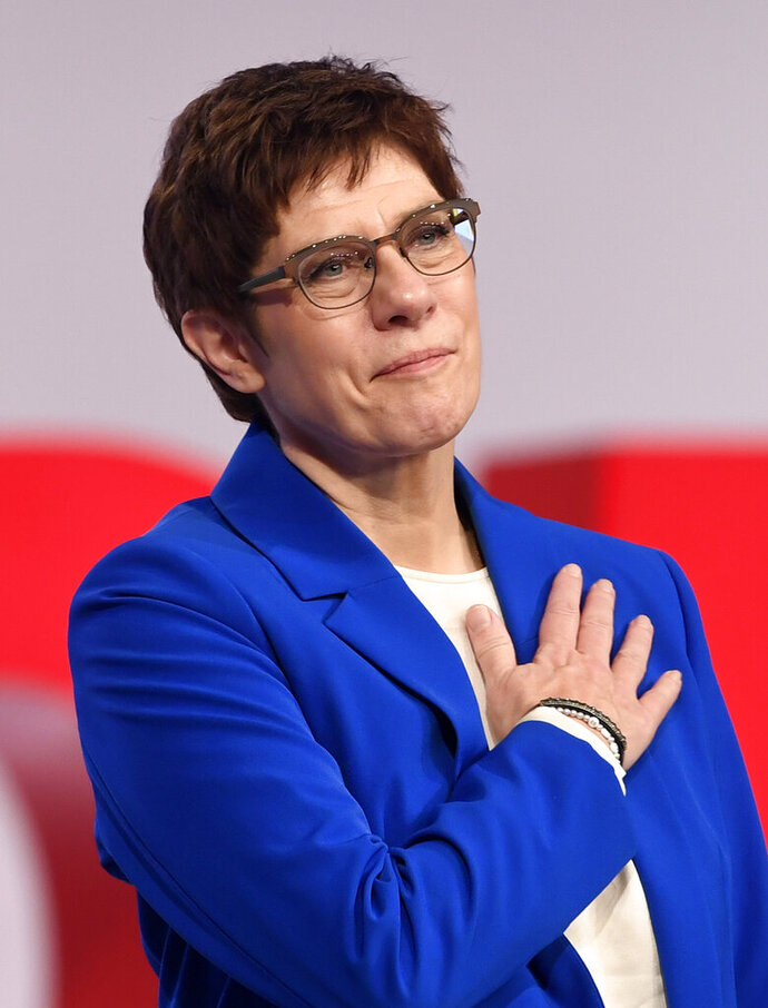 CDU party chairwoman Annegret Kramp-Karrenbauer reacts as she receives standing ovations at the German Christian Democrats Party (CDU) convention in Leipzig, Germany, Friday, Nov. 22, 2019. The CDU convention takes place from Friday, Nov. 22, to Saturday, Nov. 23, 2019. (AP Photo/Jens Meyer)