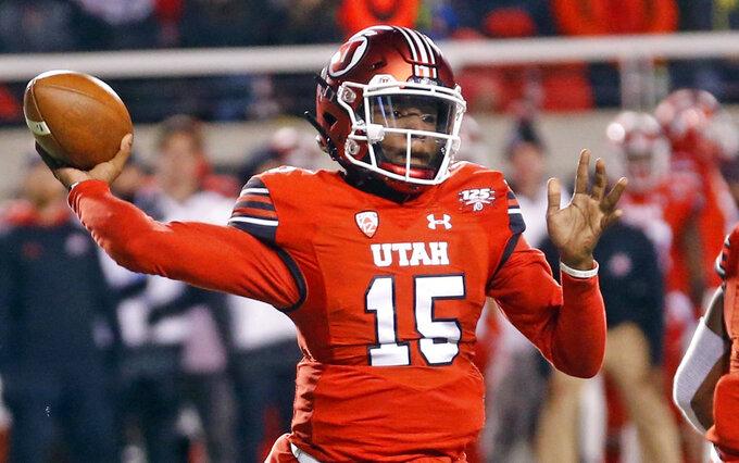 Utah quarterback Jason Shelley (15) throws against BYU in the first half during an NCAA college football game Saturday Nov. 24, 2018, in Salt Lake City. (AP Photo/Rick Bowmer)