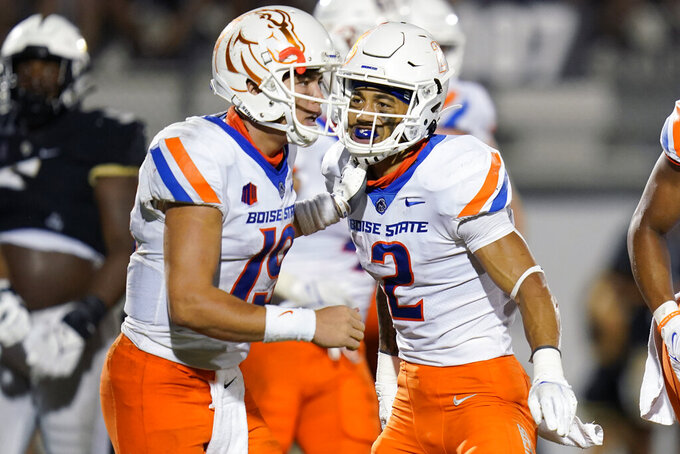 Boise State wide receiver Khalil Shakir (2) and quarterback Hank Bachmeier celebrate after 7-yard touchdown pass during the second half of the team's NCAA college football game against Central Florida, early Friday, Sept. 3, 2021, in Orlando, Fla. (AP Photo/John Raoux)