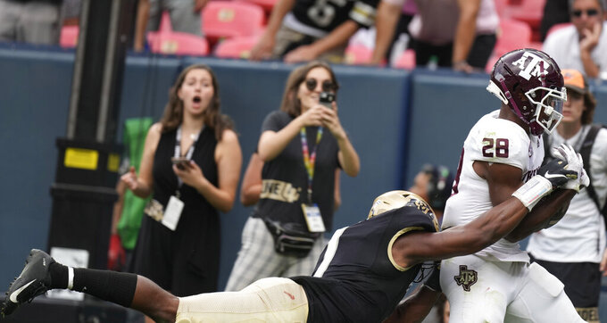 Texas A&M running back Isaiah Spiller, right, pulls in a pass for a touchdown as Colorado linebacker Guy Thomas defends in the second half of an NCAA college football game Saturday, Sept. 11, 2021, in Denver. Texas A&M won 10-7. (AP Photo/David Zalubowski)