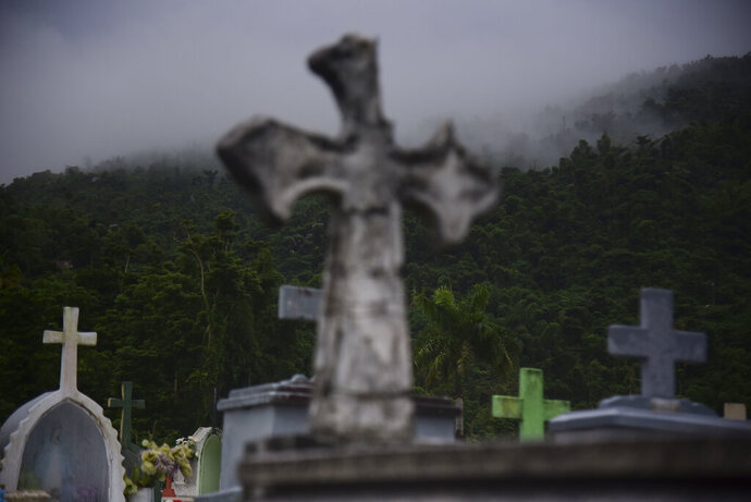 Clouds approach the Yabucoa municipal cemetery in Yabucoa, Puerto Rico, Tuesday, Sept. 24, 2019. Tropical Storm Karen regained strength as it swirled toward Puerto Rico, where it's expected to bring heavy rains and strong winds. (AP Photo/Carlos Giusti)
