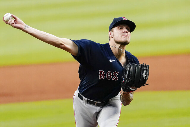 Boston Red Sox starting pitcher Tanner Houck (89) delivers a pitch in the first inning of a baseball game against the Atlanta Braves on Saturday, Sept. 26, 2020, in Atlanta. (AP Photo/John Bazemore)