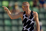 Sam Kendricks celebrates during the finals of the men's pole vault at the U.S. Olympic Track and Field Trials Monday, June 21, 2021, in Eugene, Ore. (AP Photo/Charlie Riedel)