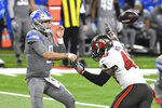 Detroit Lions quarterback Matthew Stafford (9) throws as Tampa Bay Buccaneers inside linebacker Devin White (45) rushes during the first half of an NFL football game, Saturday, Dec. 26, 2020, in Detroit. (AP Photo/Lon Horwedel)