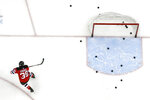 FILE - In this Feb. 17, 2019, file photo, New Jersey Devils right wing Kurtis Gabriel works out prior to an NHL hockey game against the Buffalo Sabres in Newark, N.J. The Devils are back at work after a COVID-19 wildfire landed 19 players on the NHL's isolation list and forced the postponed of seven games since the end of January. The Devils practiced Monday, Feb. 15, 2021, for the first time since beating the Sabres in Buffalo on Jan. 31. (AP Photo/Julio Cortez, File)