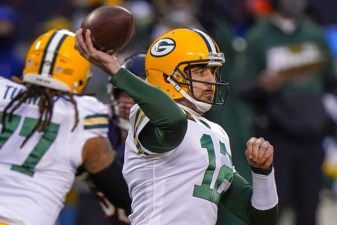 Green Bay Packers' Aaron Rodgers throws a pass during the first half of an NFL football game against the Chicago Bears Sunday, Jan. 3, 2021, in Chicago. (AP Photo/Nam Y. Huh)