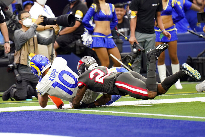 Los Angeles Rams wide receiver Cooper Kupp (10) scores a touchdown past Tampa Bay Buccaneers cornerback Carlton Davis during the second half of an NFL football game Sunday, Sept. 26, 2021, in Inglewood, Calif. (AP Photo/Jae C. Hong)