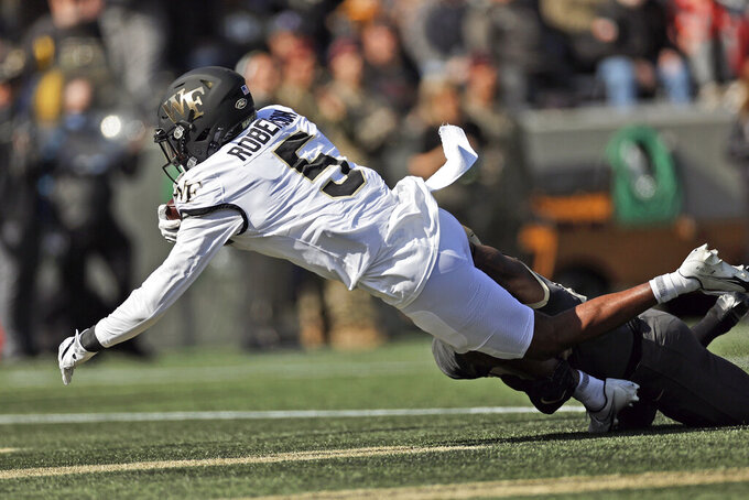 Wake Forest wide receiver Jaquarii Roberson scores a touchdown against Army during the first half of an NCAA college football game Saturday, Oct. 23, 2021, in West Point, N.Y. (AP Photo/Adam Hunger)