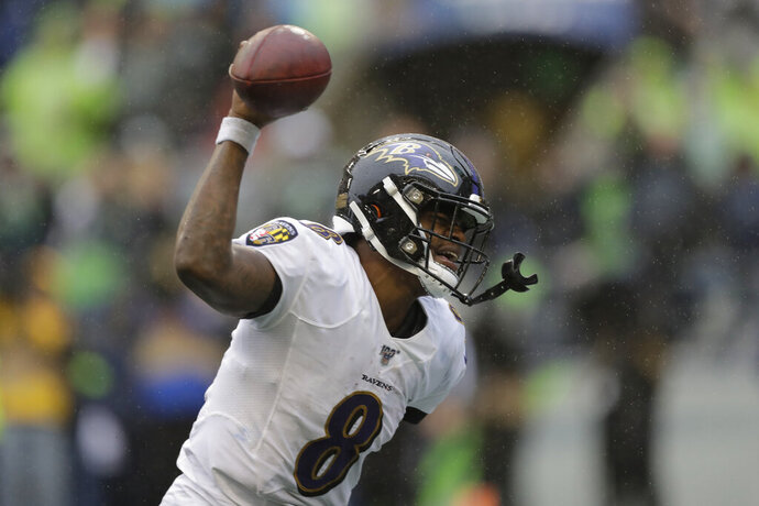 Baltimore Ravens quarterback Lamar Jackson (8) spikes the ball after a touchdown during the second half of an NFL football game against the Seattle Seahawks, Sunday, Oct. 20, 2019, in Seattle. (AP Photo/John Froschauer)