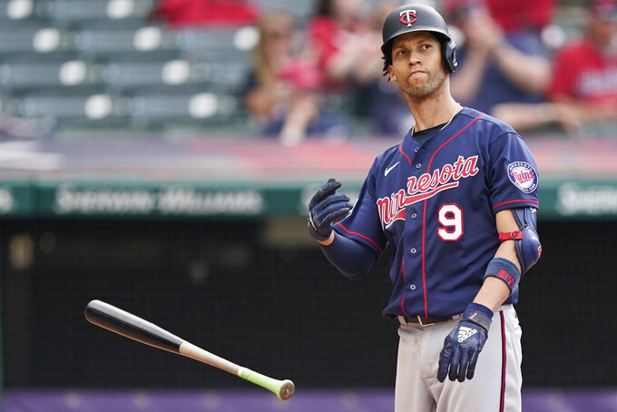 Minnesota Twins' Andrelton Simmons throws his bat after striking out with the bases loaded in the sixth inning of a baseball game against the Cleveland Indians, Saturday, May 22, 2021, in Cleveland. (AP Photo/Tony Dejak)