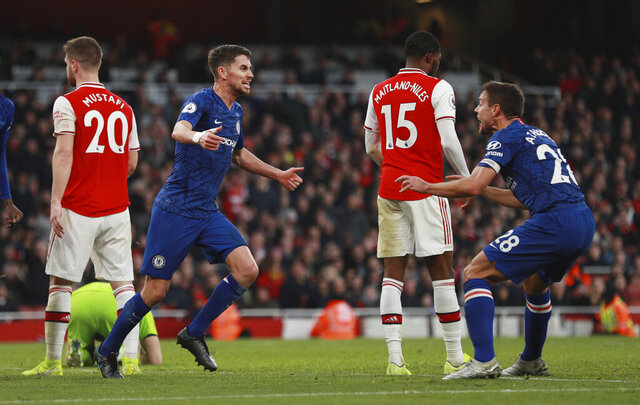 Chelsea's Jorginho, left, celebrates with his teammate Cesar Azpilicueta after scoring his side's first goal during the English Premier League soccer match between Arsenal and Chelsea, at the Emirates Stadium in London, Sunday, Dec. 29, 2019. (AP Photo/Ian Walton)