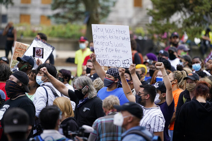 Black Lives Matter protesters march, Friday, Sept. 25, 2020, in Louisville. Breonna Taylor's family demanded Friday that Kentucky authorities release all body camera footage, police files and the transcripts of the grand jury hearings that led to no charges against police officers who killed the Black woman during a March drug raid at her apartment. (AP Photo/Darron Cummings)