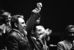 FILE - In this Feb. 8, 1986 file photo, Cuban President Fidel Castro, left, joins hands with his younger brother Raul Castro, chief of the Cuban Armed Forces and first vice president, after the two were reelected in the Third Cuban Communist Party Congress session in Havana, Cuba. Fidel ruled for nearly five decades as Cuba's