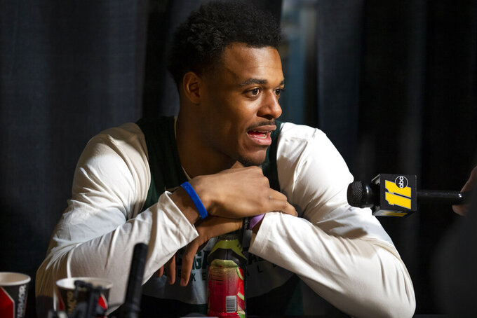 Michigan State forward Xavier Tillman speaks during an NCAA men's college basketball news conference in Washington, Saturday, March 30, 2019. Michigan State plays Duke in the East Regional final game on Sunday. (AP Photo/Alex Brandon)