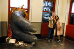 Visitors to the Empire State Building take a photo featuring an interactive King Kong exhibit, in New York, Thursday, Oct. 10, 2019. (AP Photo/Richard Drew)