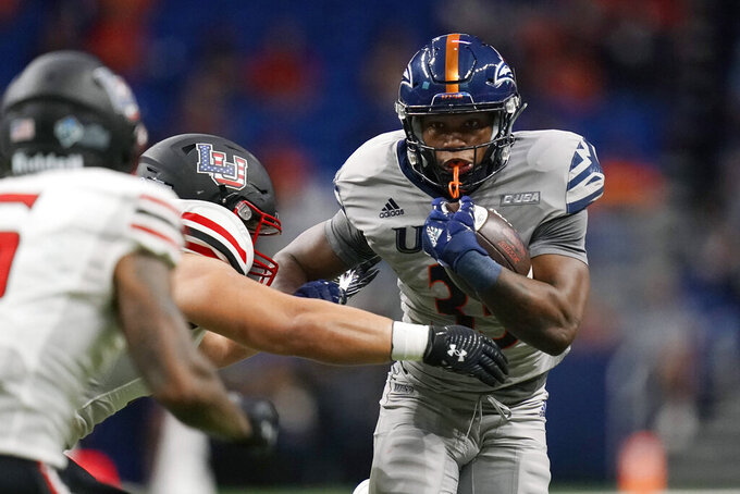 UTSA running back B.J. Daniels (33) carries against Lamar during the second half of an NCAA college football game Saturday, Sept. 11, 2021, in San Antonio. (AP Photo/Eric Gay)