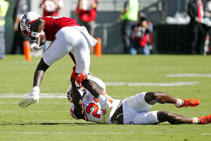 Clemson's Andrew Booth Jr. (23) tries to bring down North Carolina State's Emeka Emezie (86) during the first half of an NCAA college football game in Raleigh, N.C., Saturday, Sept. 25, 2021. (AP Photo/Karl B DeBlaker)