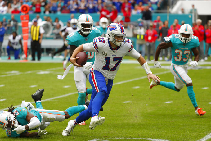 Buffalo Bills quarterback Josh Allen (17) scrambles for yards, during the first half at an NFL football game against the Miami Dolphins, Sunday, Nov. 17, 2019, in Miami Gardens, Fla. (AP Photo/Wilfredo Lee)