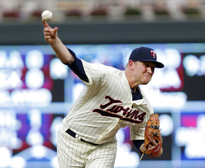FILE - Minnesota Twins' Tyler Duffy throws against the Detroit Tigers in the fourth inning during a baseball game in Minneaolis, in this Aug. 18, 2018, file photo. The Minnesota Twins signed Alex Colomé away from their chief divisional competition, the Chicago White Sox, to bring in a proven closer to the back of the bullpen. The Twins won't formally assign that role, though, with Taylor Rogers, Hansel Robles and Tyler Duffey all in position for ninth-inning outs. (AP Photo/Andy Clayton-King, File)