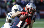 New England Patriots wide receiver Julian Edelman (11) catches a pass in front of Los Angeles Chargers defensive back Desmond King during the first half of an NFL divisional playoff football game, Sunday, Jan. 13, 2019, in Foxborough, Mass. (AP Photo/Charles Krupa)