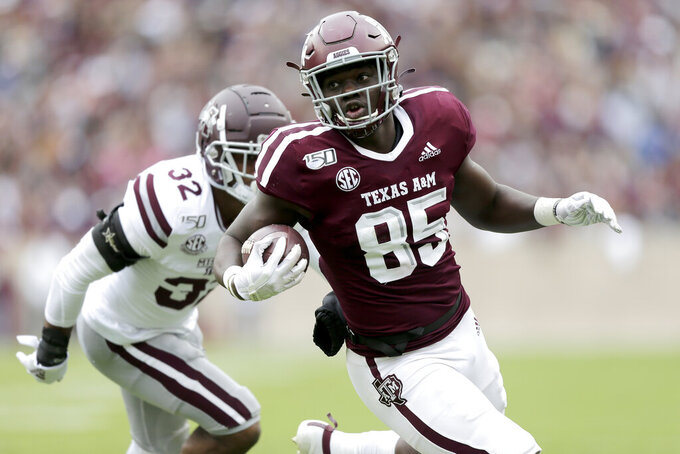 Texas A&M tight end Jalen Wydermyer (85) looks towards the end zone after fighting off Mississippi State safety Brian Cole II (32) during the first half of an NCAA college football game, Saturday, Oct. 26, 2019, in College Station, Texas. (AP Photo/Sam Craft)