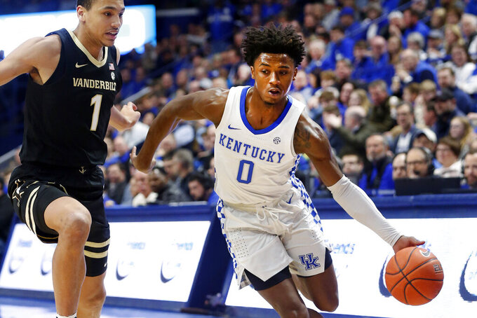 Kentucky's Ashton Hagans (0) drives on Vanderbilt's Dylan Disu (1) during the first half of an NCAA college basketball game in Lexington, Ky., Wednesday, Jan 29, 2020. (AP Photo/James Crisp)