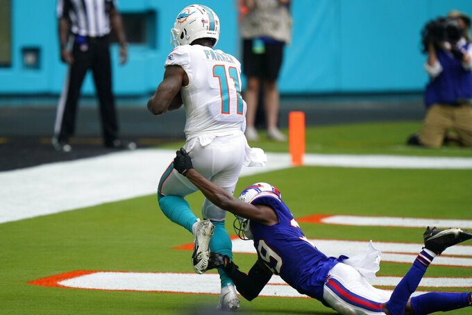 Miami Dolphins wide receiver DeVante Parker (11) scores a touchdown as Buffalo Bills cornerback Levi Wallace (39) attempts to tackle, during the first half of an NFL football game, Sunday, Sept. 20, 2020 in Miami Gardens, Fla. (AP Photo/Wilfredo Lee)