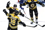 Boston Bruins center Patrice Bergeron celebrates his goal with right wing David Pastrnak (88) during the second period of the team's NHL hockey game against the Tampa Bay Lightning, Thursday, Oct. 17, 2019, in Boston. (AP Photo/Elise Amendola)