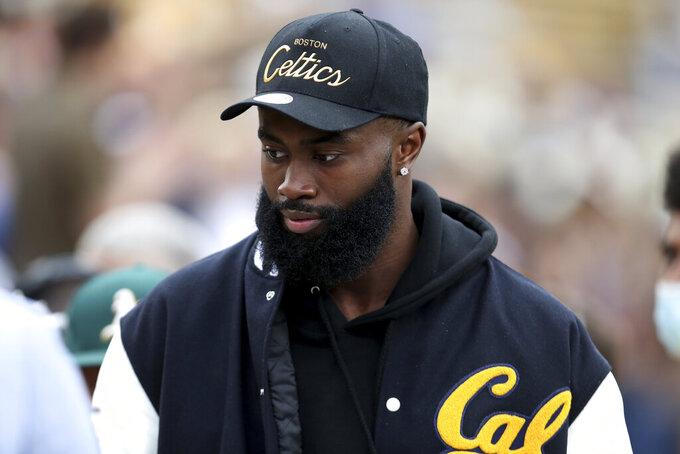 Boston Celtics NBA player Jaylen Brown walks on the sidelines during the California and Sacramento State NCAA college football game on Saturday, Sept. 18, 2021, in Berkeley, Calif. (AP Photo/Jed Jacobsohn)