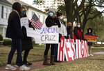 """Demonstrators stand in front of Texas Sen. Ted Cruz's home demanding his resignation, Thursday, Feb. 18, 2021, in Houston. The Republican senator said his family vacation to Mexico was """"obviously a mistake"""" as he returned stateside Thursday following an uproar over his disappearance during a deadly winter storm. (Marie D. De Jesús/Houston Chronicle via AP)"""