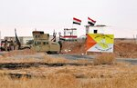 Iraqi security forces secure the Iraq-Syria border around Rabiaa border crossing, Iraq, Wednesday, Oct. 16, 2019. Najah al-Shammari, Iraq's defense minister said that some members of the Islamic State group were able to flee northern Syria and cross into Iraq. The Iraqi official added that some of them are still at large while others were detained. (AP Photo/Hadi Mizban)
