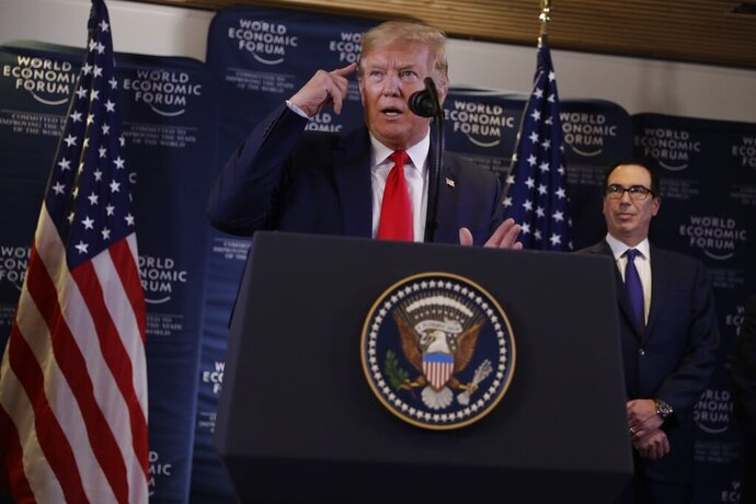 US President Donald Trump speaks during a news conference at the World Economic Forum in Davos, Switzerland, Wednesday, Jan. 22, 2020. Trump's two-day stay in Davos is a test of his ability to balance anger over being impeached with a desire to project leadership on the world stage. (AP Photo/Evan Vucci)